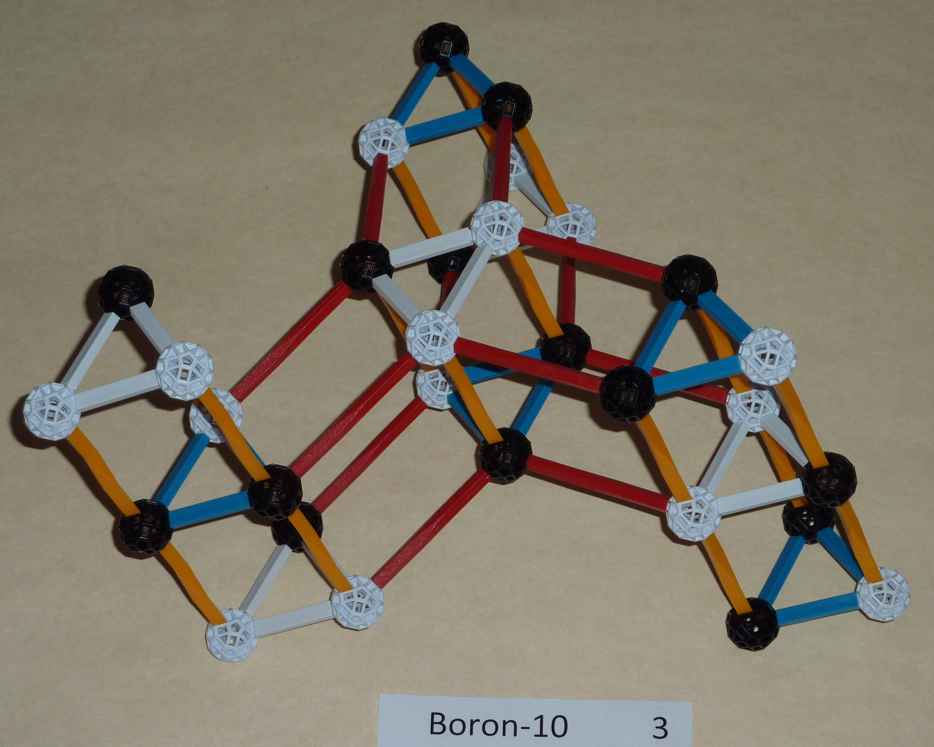 First possibility for Boron10.   One of the protons on the end of a   star spoke is capped by a neutron. One of the other spokes neutron is  capped by a proton.
